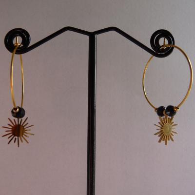 Soleil en acier doré, pierre noire 16€
